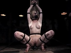 Fayth Deluca tormented in leather and metal device bondage