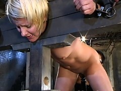 Vendetta gets flogged and fucked hard while in wooden stocks.