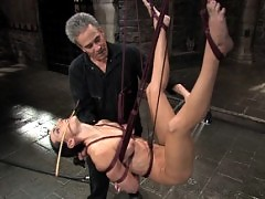 Hard-bodied girl is tied and tickled.